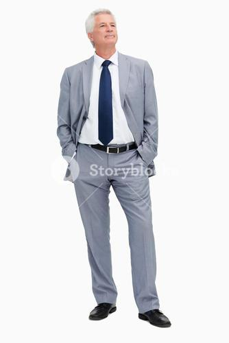 Man in a suit with hands in the pockets