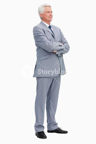 Man in a suit with folded arms