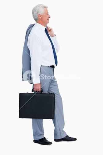 Profile of a relaxed businessman with a suitcase
