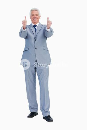 Portrait of a businessman with thumbs up