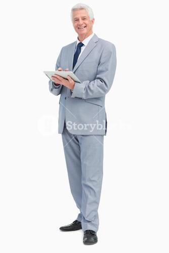 Portrait of a businessman with a touch pad