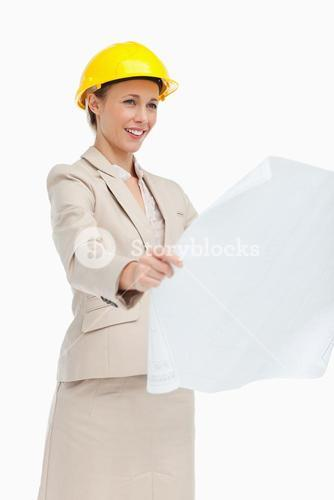 Woman in a suit looking at plans