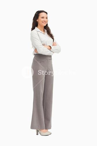 Businesswoman standing with folded arms