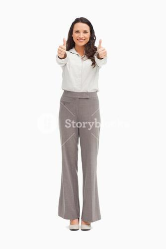 Portrait of a smiling businesswoman giving the thumbs up