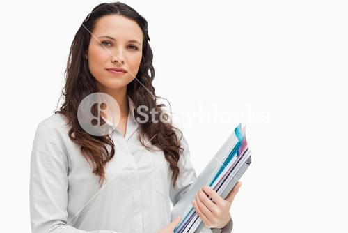 Brunette woman holding files