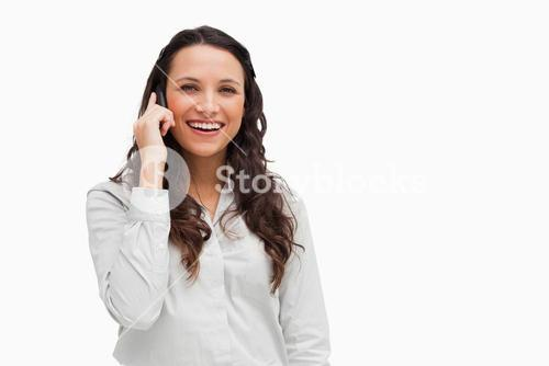 Brunette woman speaking on the phone