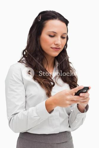 Brunette woman texting