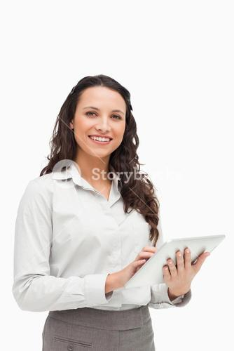 Portrait of a brunette standing while using a tablet
