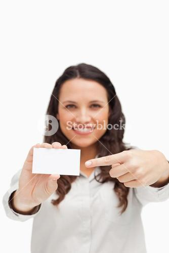 Brunette showing and pointing at a card