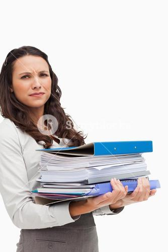 Brunette carrying a lot of files