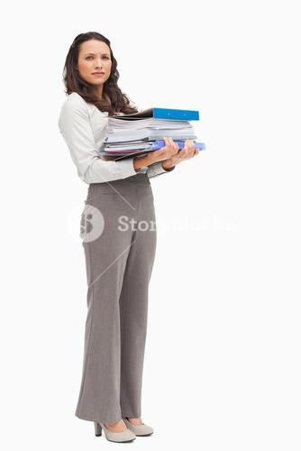 Woman carrying a lot of files