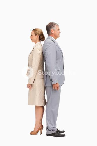 Business people standing back-to-back