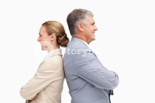 Business people laughing back-to-back