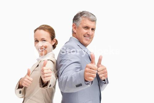 Portrait of business people approving back-to-back