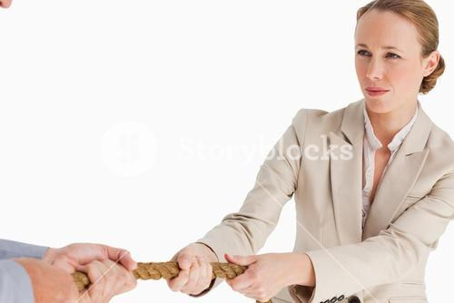 Businesswoman pulling the rope