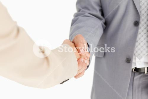 People in suit shaking hands