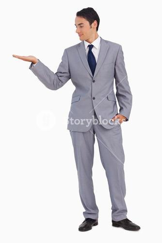Goodlooking man presenting with the hand