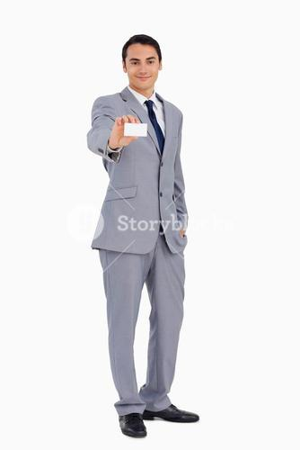 Goodlooking man showing his business card
