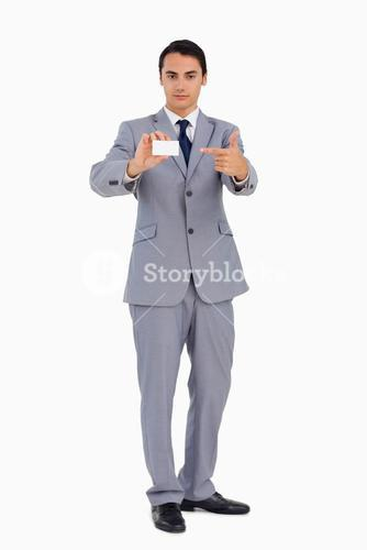 Goodlooking man showing and pointing at his business card