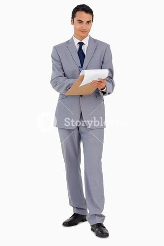 Portrait of a man holding a file