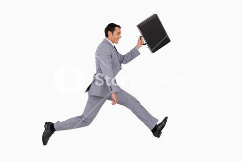 Businessman running with a suitcase