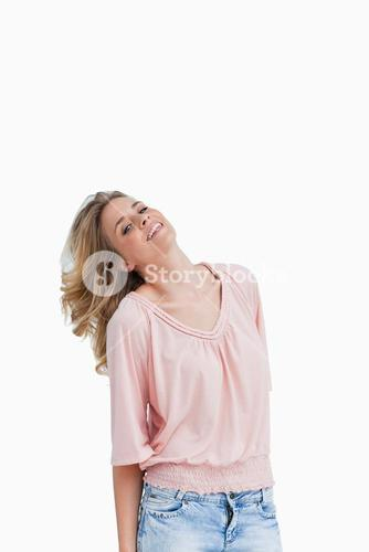 Smiling blonde woman holds her head back