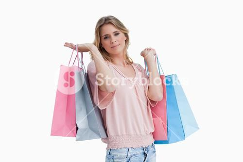 A woman carrying shopping bags over her shoulder