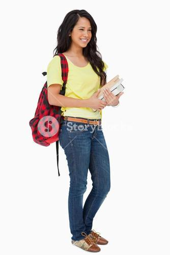 Smiling woman student with backpack holding textbooks