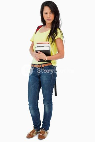 Pretty woman student with backpack holding textbooks
