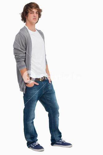 Handsome student posing hands in pockets