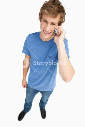 Fisheye view of a male student on the phone