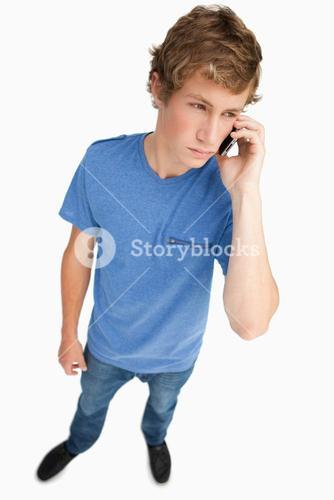 Fisheye view of a young man phoning
