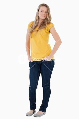 Young woman posing hands in the pockets