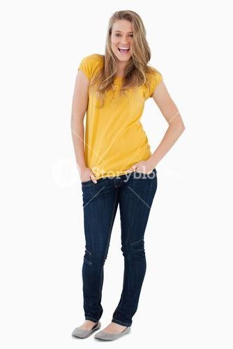 Smiling young woman posing hands in the pockets