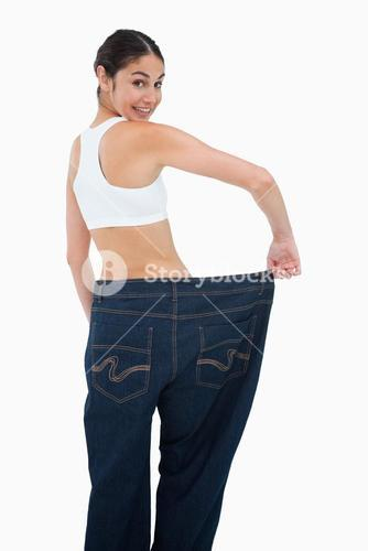 Rear view of a happy woman who lost a lot of weight
