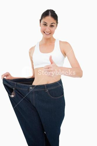 Smiling woman who lost a lot of weight the thumbup