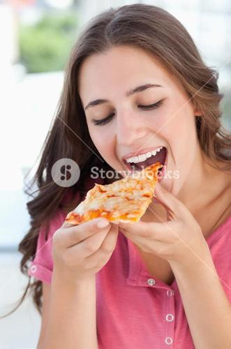A woman about to eat pizza