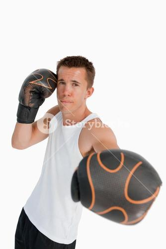 Boxer attacking with his left fist