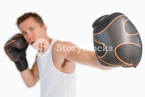 Fist of attacking boxer