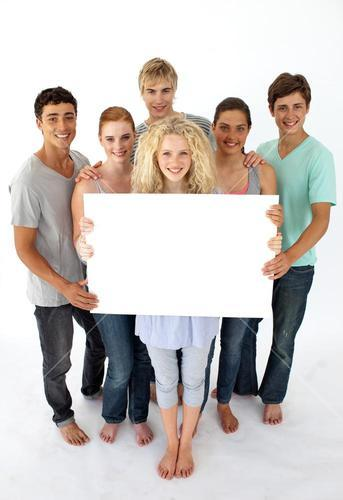 Group of teenagers holding a blank card