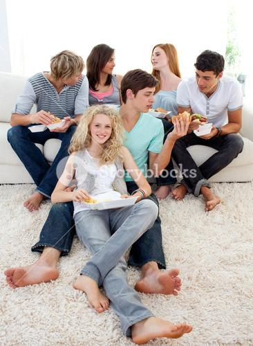 Teenagers eating burgers and fries