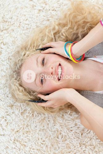 Teen girl listening to music