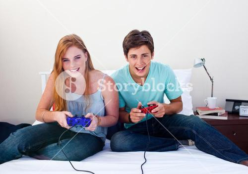 A couple of teenagers playing video games