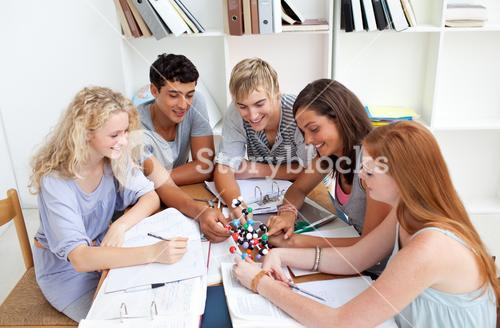 Teenagers studying Science in a library