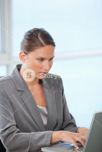 Businesswoman typing on a computer