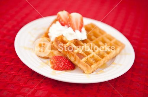 Half cut strawberry and whipped cream