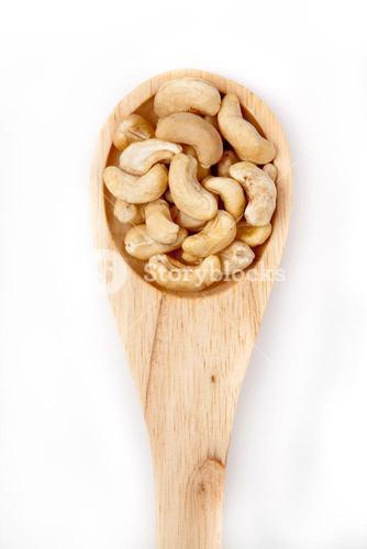 Wooden spoon with cashew nuts