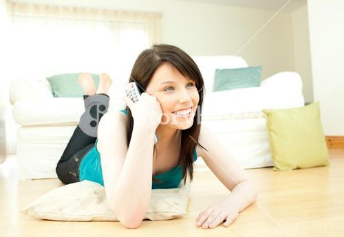 Positive woman watching television