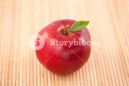 Apple on a tablecloth