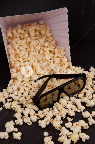 3D glasses on falling pop corn out of a box